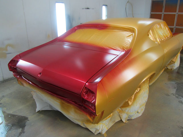 Applying first coat of red 2